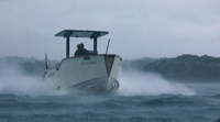 X Shore EElex electric boat rides through choppy water