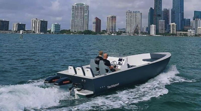 Canadian Electric Boat Company open speedboat in Miami harbour with skyline in background