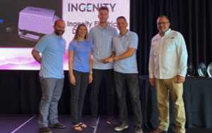 Nautique all-electric ski boat developers accepting the Miami Boat Show Innovation Award