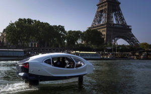 SeaBubbles electric hydrofoiling pod goes along the Seine River past the Eiffel Tower