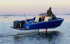 electric foiling boat Candela flies above the water