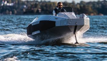 The new electric hydrofoiling boat 'flies' across the water towards the camera