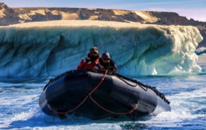 150 hp electric outboard will go on a Zodiac Milpro Mark 5 like this one exploring arctic water with iceberg in background
