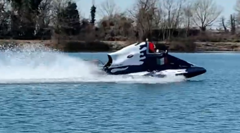 Boat with electric hydrojet doing a test run on a small lake