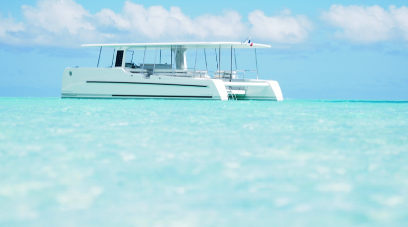 solar electric yacht floating in the aquamarine waters of the South Pacific