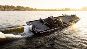 electric boat packages: The Tracker bass boat speeds along a lake