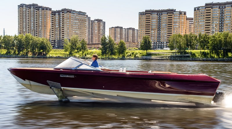 electric hydrofoiling boat speeds along a river in Moscow