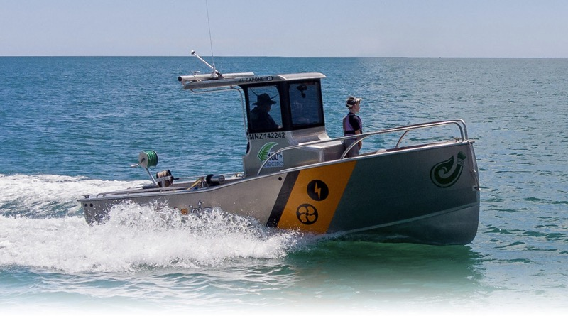 one of the electric commercial boats cuts through ocean waters