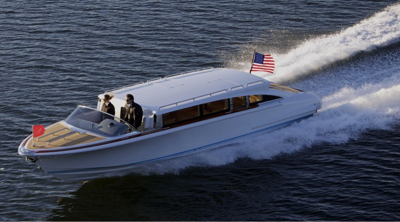 New Hodgdon electric tenders include this 10.5 m model cruising along the shoreline