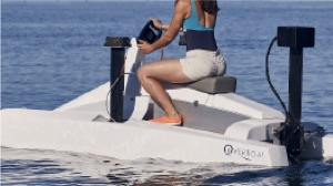 electric hydrofoiling catamaran in the water before 'lift off'
