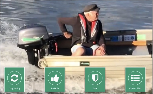 EClass Outboard - man driving boat with electric motor