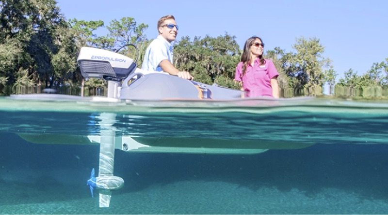 ePropulsion outboard electric motor on an inflatable with two people fishing