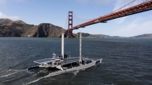 Energy Observer hydrogen ship sailinh under the arches of the Golden Gate bridge