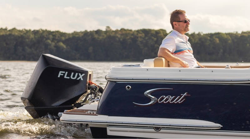 new electric outboard form Flux Marine on the stern of a Scout boat travelling along the water