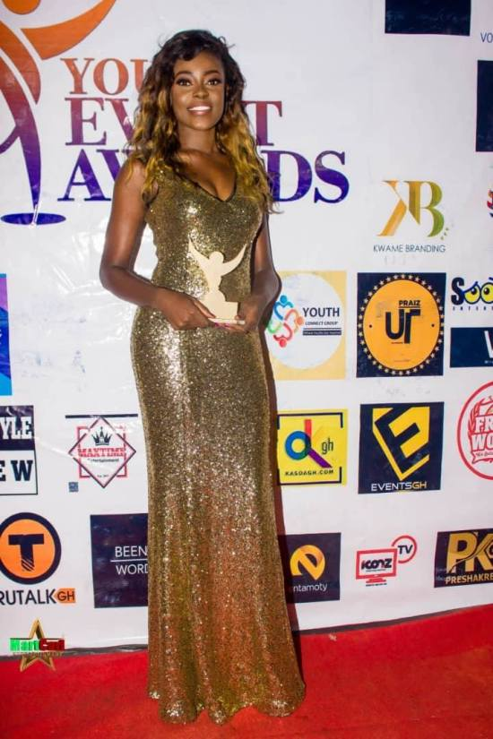 Araba Sey poses with her award plaque