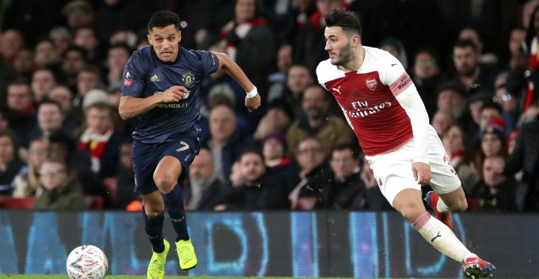 Manchester United's Alexis Sanchez (left) and Arsenal's Sead Kolasinac battle for the ball during the FA Cup, Fourth Round match at the Emirates Stadium, London.