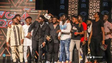 Medikal and the AMG Business team giving acceptance speech after receiving award