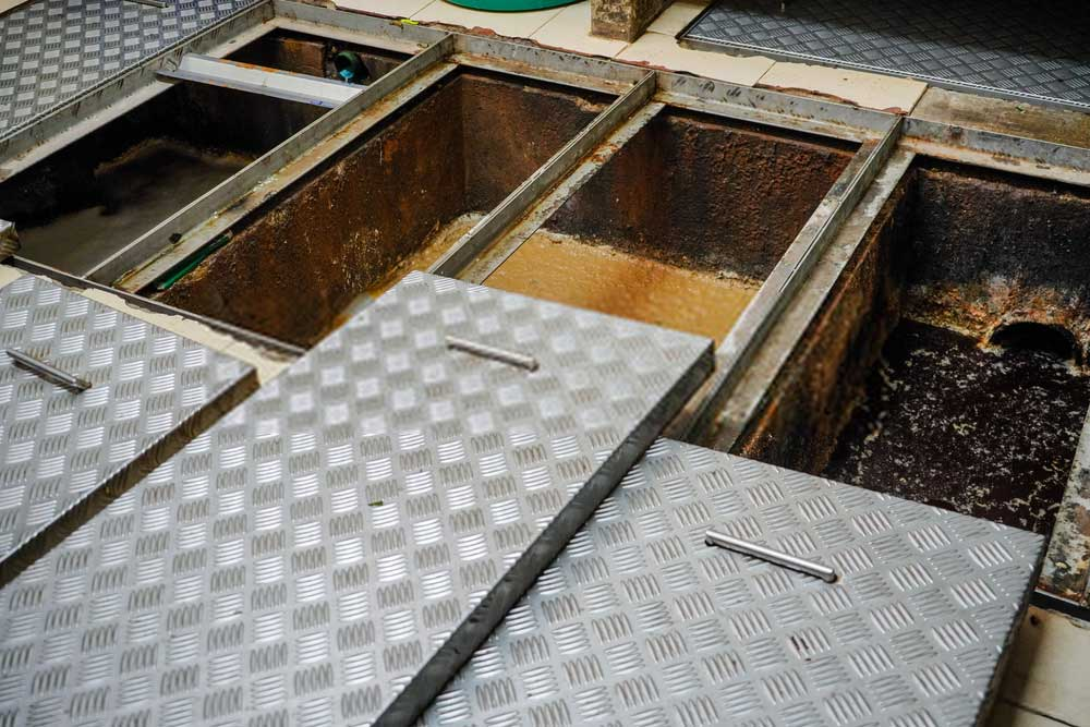 Grease traps are an essential part of kitchens and vital in the commercial kitchens and restaurants. Their help keep the harmful material such as oils, fats, and other chemicals from entering the drainage system that could result in destruction of water drain systems. But installing a grease trap does not guarantee a lifetime protection from these harmful materials. Once in a while, you need grease trap cleaning services depending upon the type of business you own. We understand that keeping up to date maintenance of grease traps while dealing with other administrative tasks is a difficult task. Often the grease traps become inefficient when a lot of grease accumulates inside the grease traps. These problems lead to clogging, unpleasant odors and in severe cases the generation of harmful microorganisms that threaten the quality of food and health of customers and workers. You do not need to worry; we offer the right services for your commercial businesses in London.