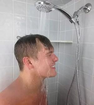 Man using Vida Alegría H5+ 2.5GPM Handheld Shower Head.