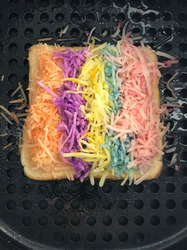 In honor of National Find A Rainbow Day and National Grilled Cheese Month, we made an Air Fryer Grilled Cheese Rainbow Sandwich recipe.