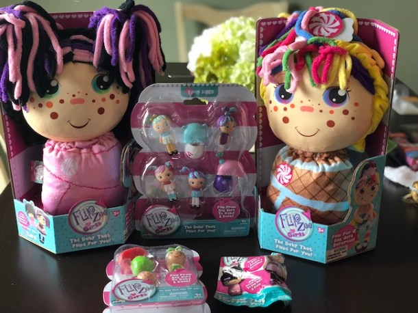 Have you seen the commercials for the Flip Zee Girls yet? They are a doll that converts from a baby to a big girl, by simply flipping the bonnet or swaddle.