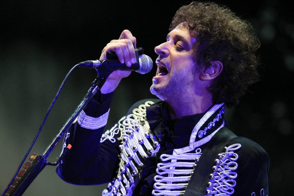 """Argentine musician Gustavo Cerati is seen on stage on May 15, 2010 during his """"Fuerza Natural (Natural Force) 2009-2010"""" tour in Caracas. Cerati underwent brain surgery after suffering a transient ischemic attack at the end of the concert in the Venezuelan capital. The rocker is in critical condition according to doctors, but have said that his situation is stable and has not shown sgns of neurological deterioration. AFP PHOTO/El Universal/Kisai Mendoza -------------RESTRICTED TO EDITORIAL USE/NO SALES/GETTY OUT------------------- (Photo credit should read Kisai Mendoza/AFP/Getty Images)"""