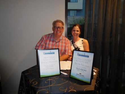 Bob Hamill (senior underwriter with FCCI Insurance Group, not affiliated with PLUS) and Whitney Tabash selling mulligans, professional shots and entries into the putting contest at the Caring for Kids Banquet April 27th