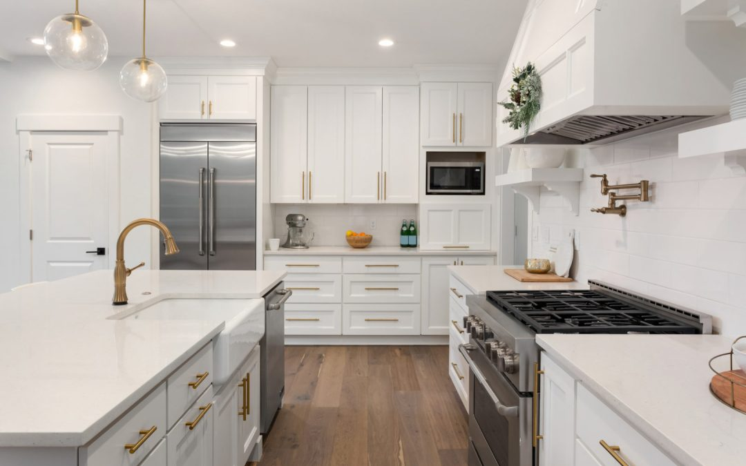 beautiful modern white kitchen with gold hardware
