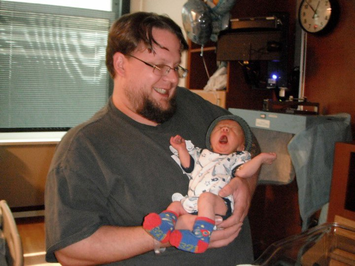 Dad holding newborn