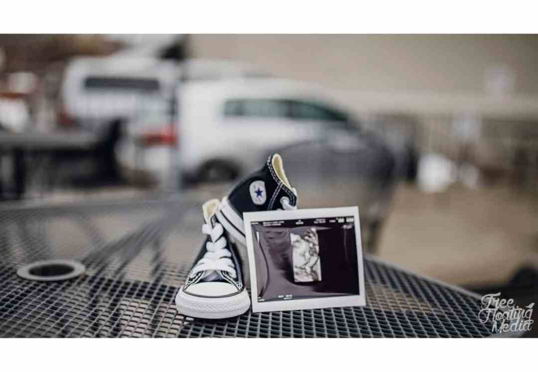 ultrasound and baby shoes maternity photo