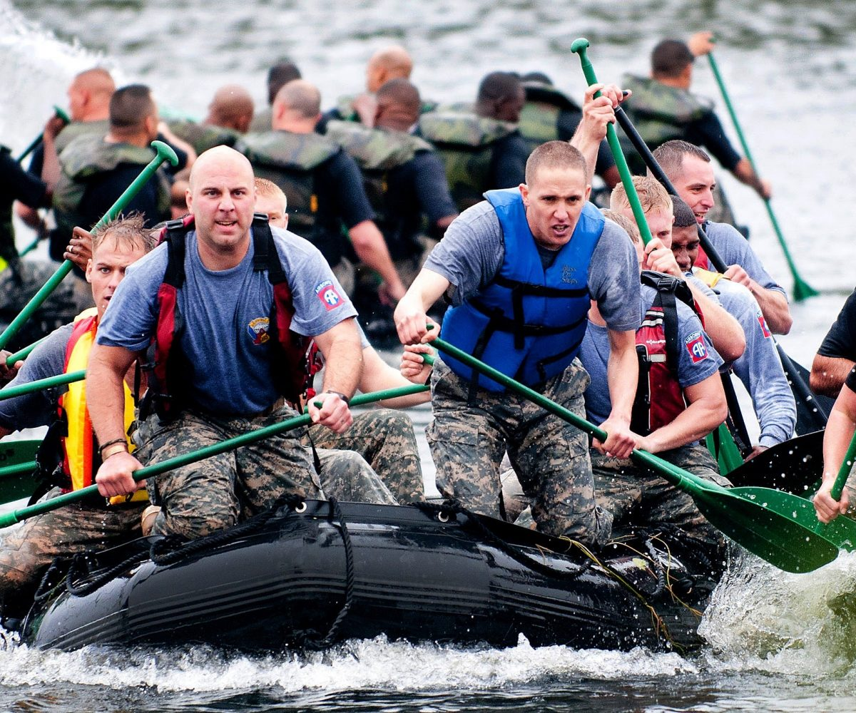 men-paddling-in-inflatable-raft-boat-during-daytime-39621