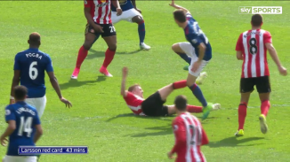 Larsson still appears out of control after the tackle.