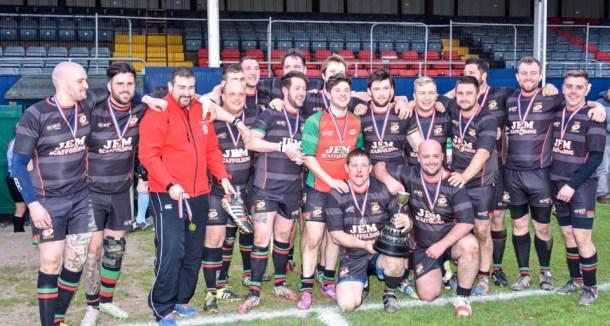 Tamar Saracens IIs celebrate winning the Pedrick Cup