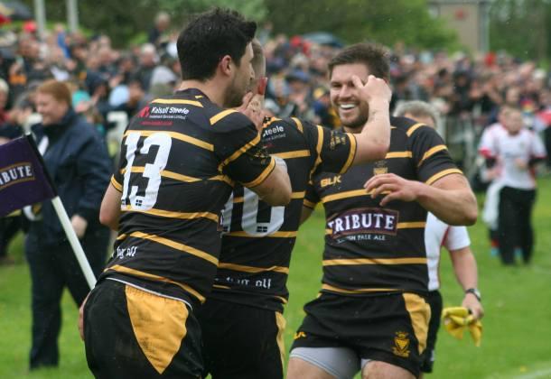 Jake Murphy celebrates with Searle and Webber