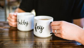 Couple's hubby and wifey matching coffee cups during their Jobot engagement session by PMA Photography