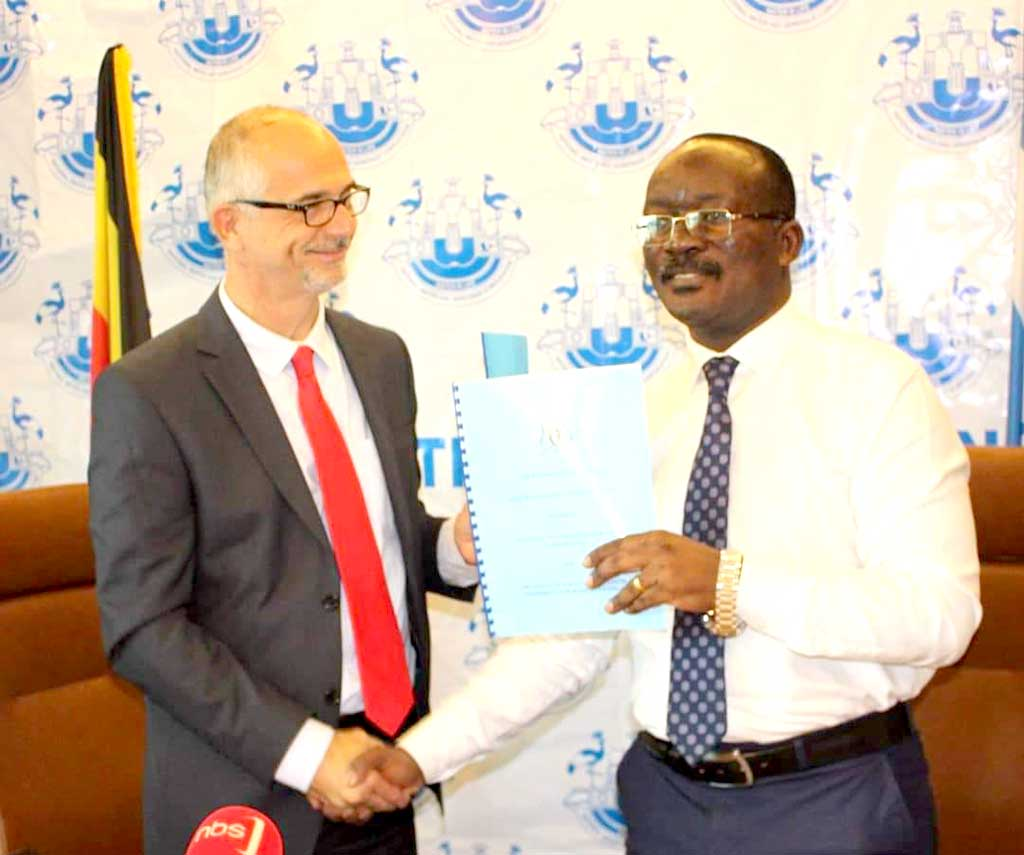 Mr Joel Boutroue, UNHCR Representative in Uganda and Dr. Eng. Silver Mugisha, the Managing Director of NWSC after signing a landmark agreement that will ensure reliable water provision for more than 84,000 refugees