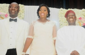 ..Chief Bisi Akande, with the lucky couple...