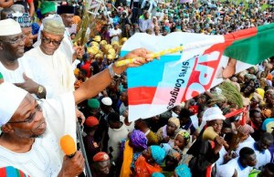 Governor of Osun, Ogbeni Rauf Aregbesola; Candidate of All Progressive Congress (APC), for the Osun West Senatorial By-Election, Senator Mudashir Husain; Kebbi State Governor, Abubakar Bagudu (in blue cap); National Chairman, All Progressive Congress (APC), Chief John Oyegun, at the Mega Rally for the forthcoming Osun West Senatorial Bye-Election in the State, held in Iwo on Thursday…