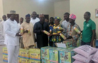 Kwara State government officials with the farmers during the presentation...