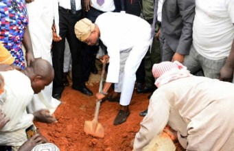 Governor Rauf Aregbesola...performing the last duty for his late mother after the burial in Ilesa on Tuesday...