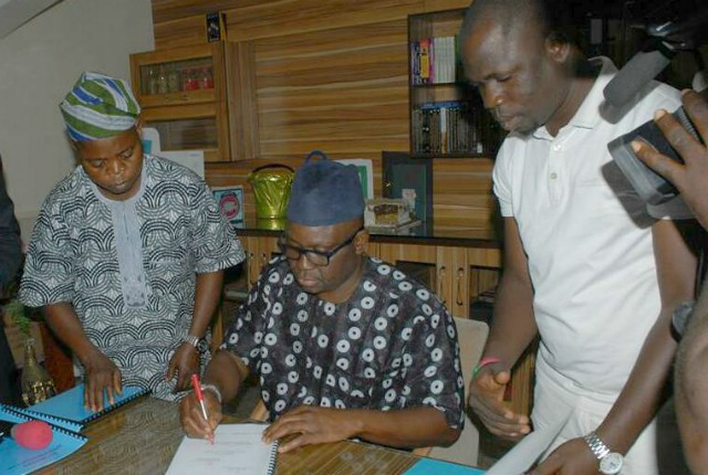 Governor Ayodele Fayose of Ekiti State...signs the new law...