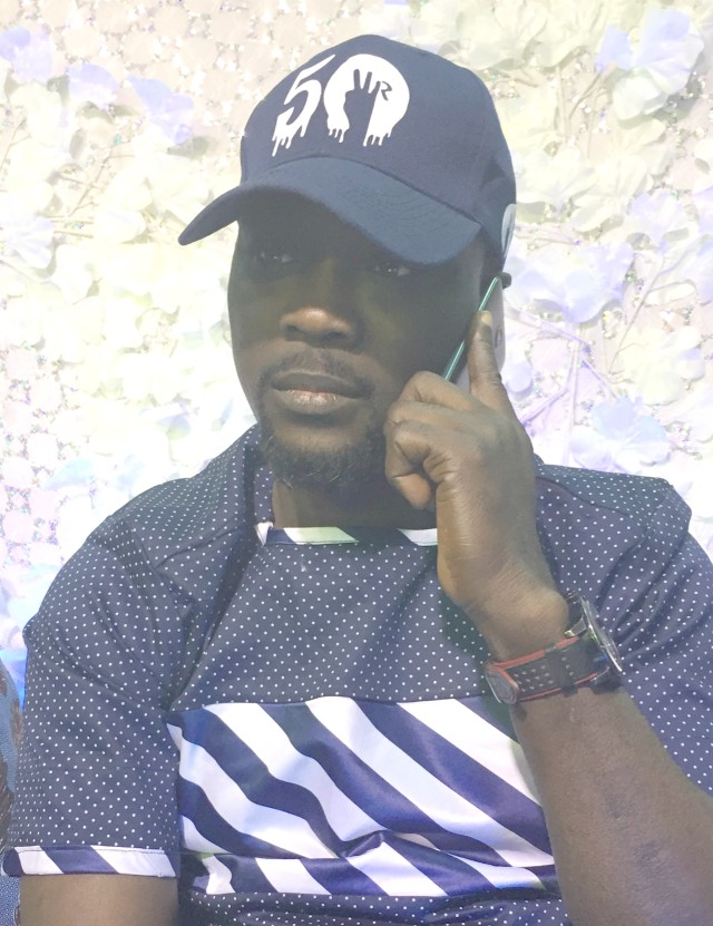 The Celebrant, Wasiu Alabi Pasuma...answering unending congratulatory telephone calls....