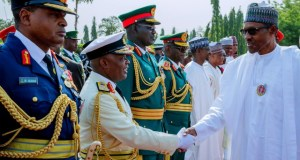 President Muhammadu Buhari, right, with Service Chiefs...