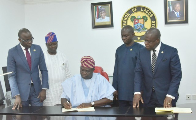 Lagos State Governor Akinwunmi Ambode (middle), signing the Seven bills into Law in his Office at the Lagos House, Ikeja, on Thursday, February 8, 2018. With him are Attorney General/Commissioner for Justice, Mr. Adeniji Kazeem (right); Commissioner for Energy & Mineral Resources, Mr. Olawale Oluwo (2nd right); Commissioner for Information & Strategy, Mr. Kehinde Bamigbetan (2nd left) and Commissioner for Finance, Mr. Akinyemi Ashade (left)…