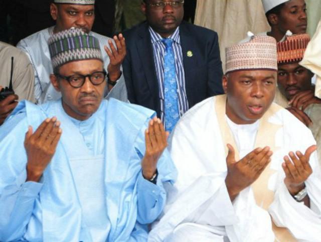 President Muhammadu Buhari, left, with Senator Bukola Saraki...praying for the dead...