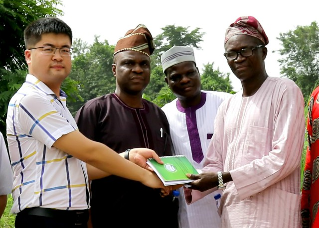 The Oyo State Hon. Commissioner for Environment & Water Resources, Chief Isaac Ishola (Right), handing over the Eleyele Dam site to a representative of Messrs CGC-CHWE, Mr. Lee, while the Permanent Secretary of the Ministry, Mr. Gabriel Oguntola (2nd Right) and the Project Coordinator of IUFMP, Mr. Dayo Ayorinde, watch with admiration…