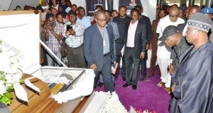 Governor Abiola Ajimobi, right, paying his last respect to the remains of Hon Michael Adeyemo...