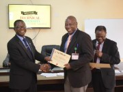 The Vice-Chancellor, Professor Ayobami Salami (left) presenting a certificate to Mr. Dipo Fagbamila after the workshop