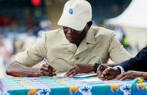 Adams Oshiomhole...signing in as new APC Chairman...