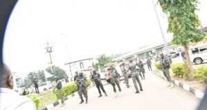 ...Governor Ayodele Fayose, left, confronting the security agents...on Wednesday...